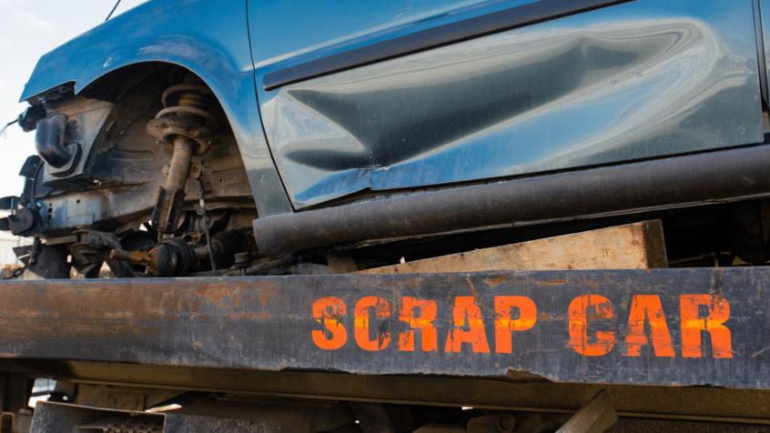 visual image of scrap car on rig